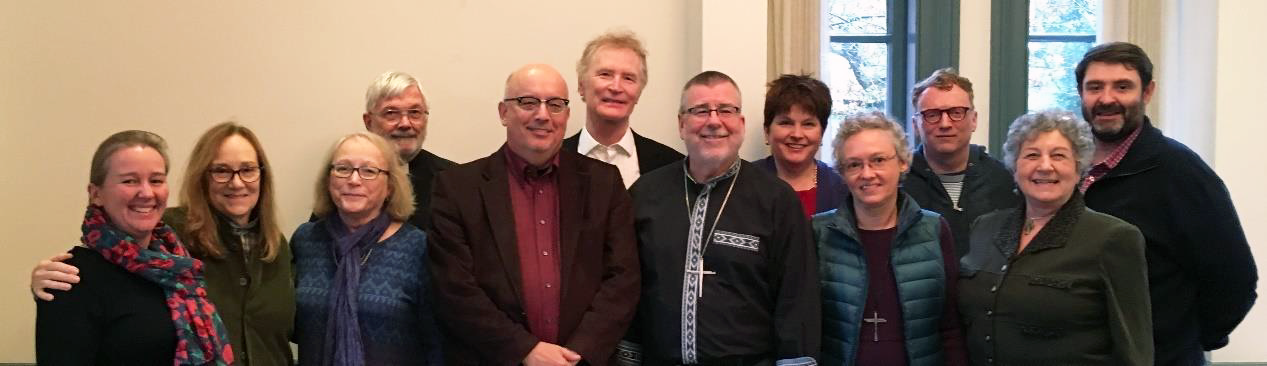 Board members at November 2018 meeting, Virginia Theological Seminary [L to R, front] Alice Farnhill (guest, CCN Coventry), Sarah Buxton-Smith, Virginia Mauer, John Downey, Mark Pendleton, Erin Newton, Marilyn Peterson  [L to R, back] Jim Warnock, Robert Childers, Angela Shelley, Brian Crisp (guest, Pullen Memorial Baptist Church, Raleigh, NC), Robert Heaney.